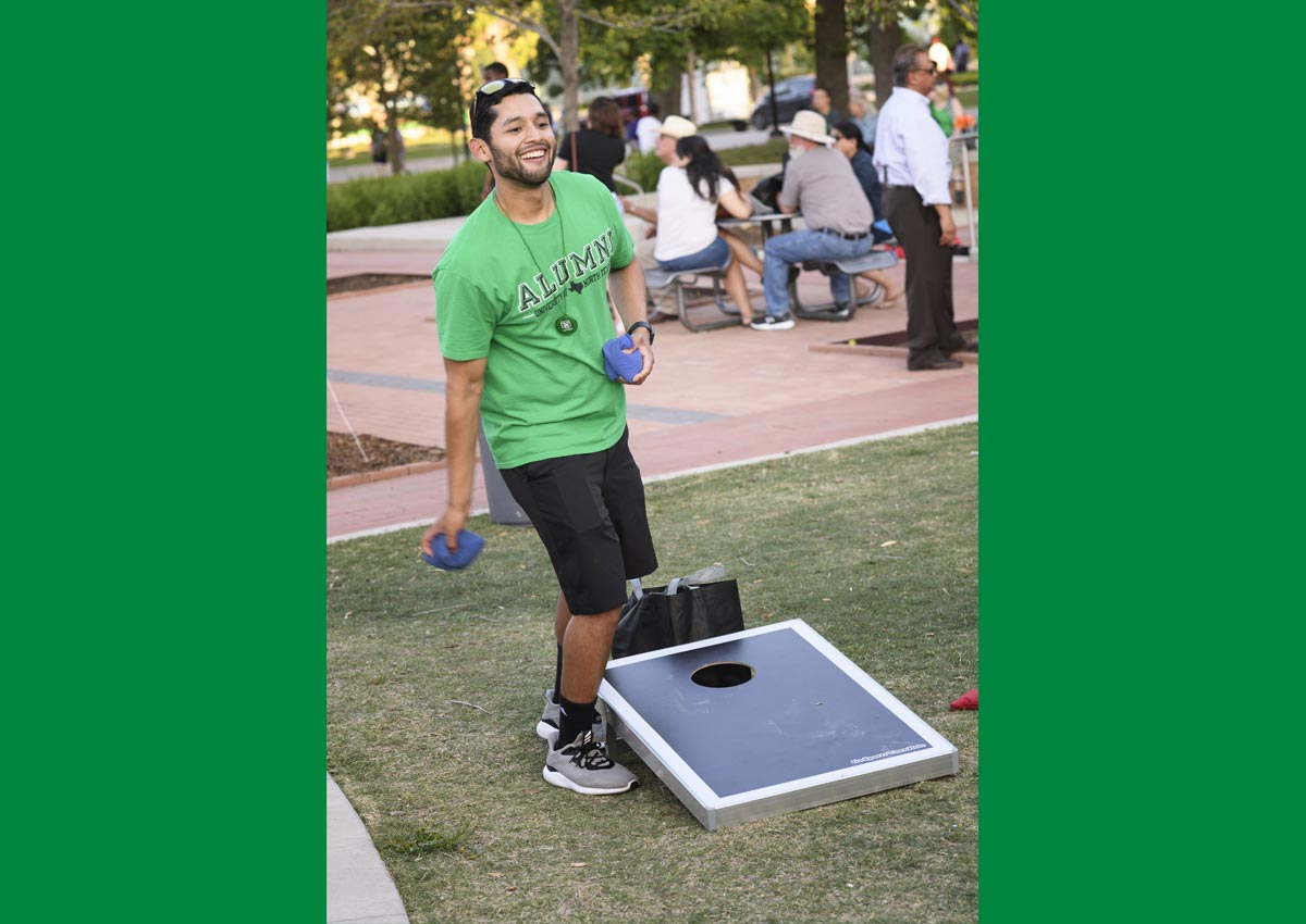 Playing cornhole at the 2018 Block Party