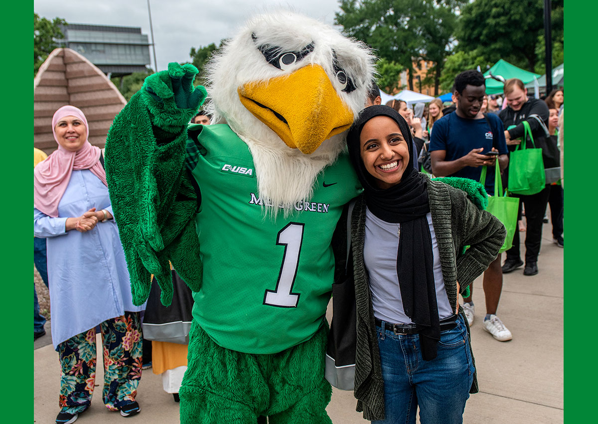 Student posing for picture with Scrappy at 2019 Block Party